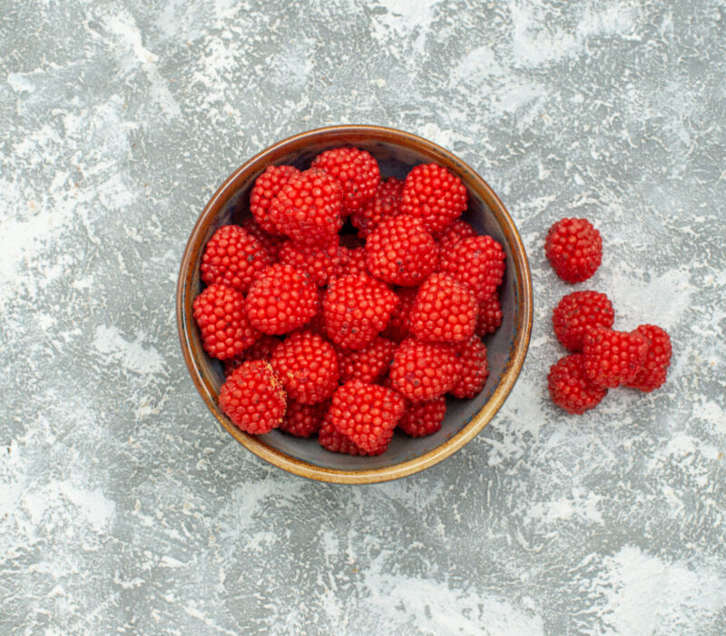 top-view-red-raspberry-confitures-inside-pot-white-background-candy-confiture-sweet-sugar-tea